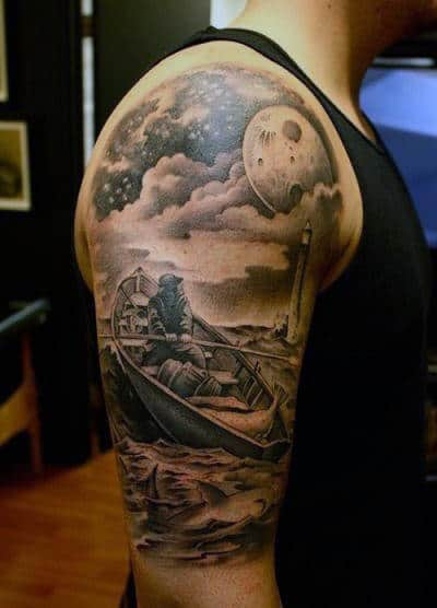 Guy With Moon And Clouds Tattoo