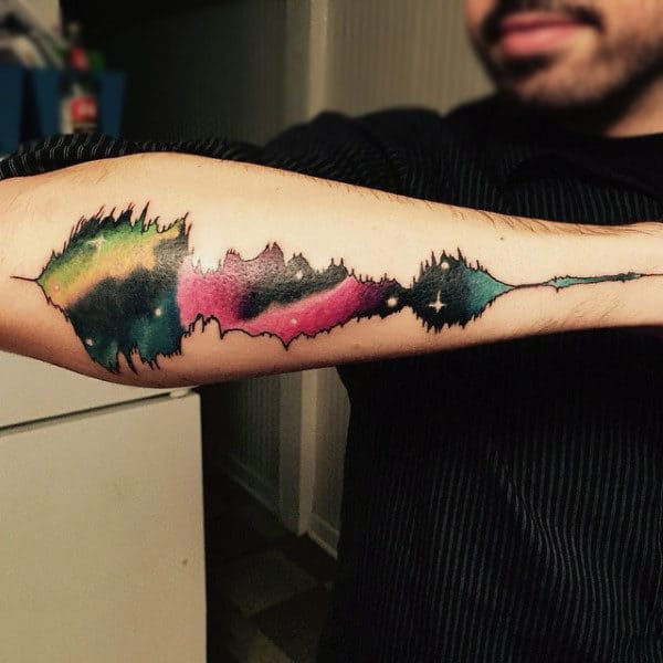 Guy With Musical Waves Tattoos Outer Forearm