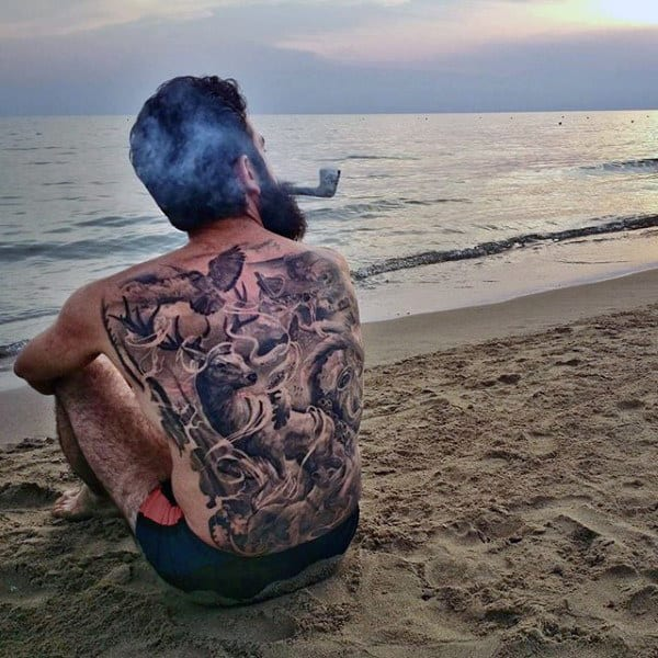 Guy With Muti Horned Unicorn And Bird Tattoo Full Back