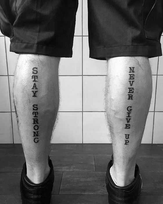 Guy With Never Give Up Tattoo Design On Back Of Legs