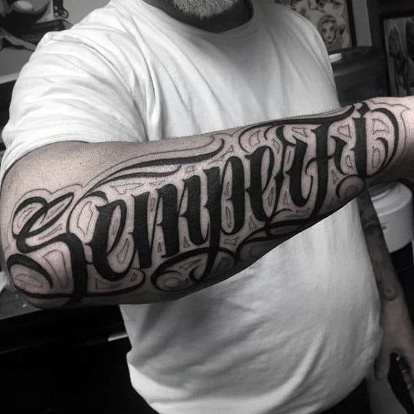 Guy With Pitch Black Lettering Tattoo Forearms
