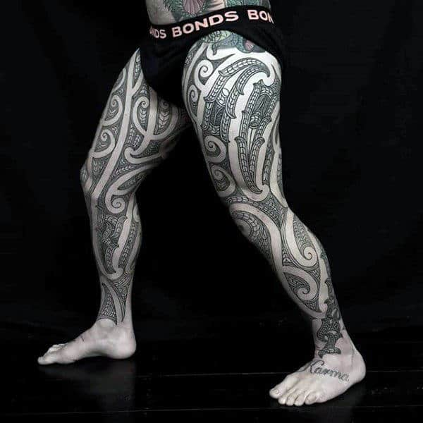 Guy With Polynesian Full Leg Sleeve Tribal Thigh Tattoo Designs