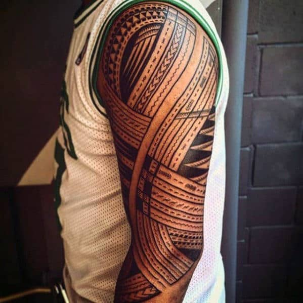 Guy With Polynesian Sleeve Tribal Tattoos