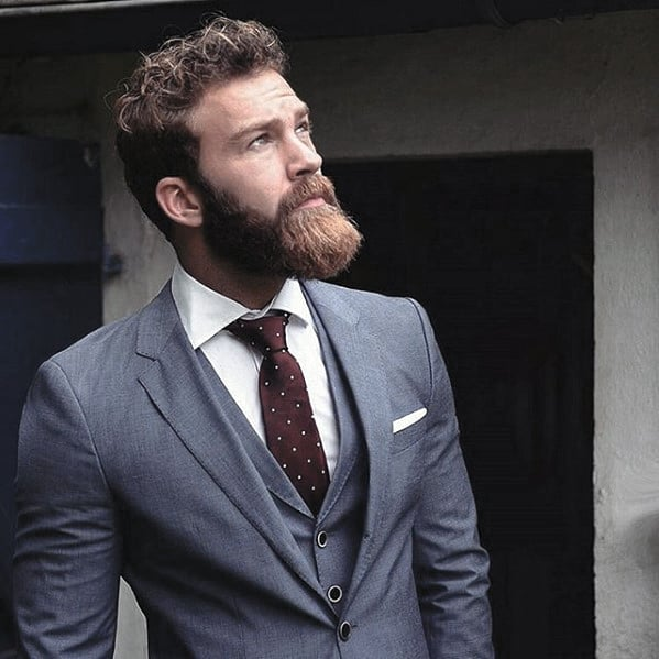 Guy With Professional Cool Beard Styles In Blue Suit