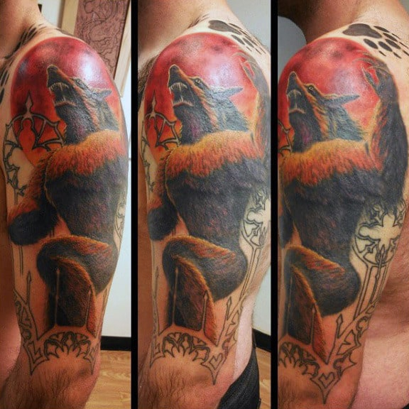Guy With Raging Red Sun And Werewolf Tattoo Arms