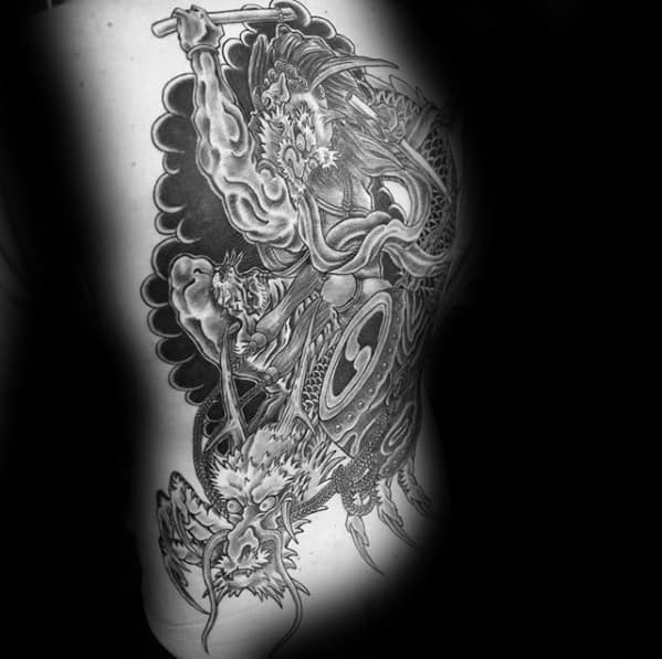 Guy With Raijin Tattoo Design