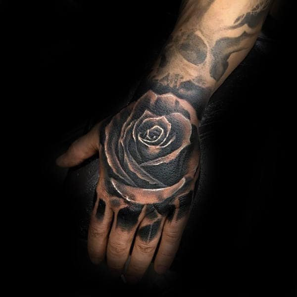 Guy With Realistic Grey And Black Ink Rose Flower Hand Tattoo Design