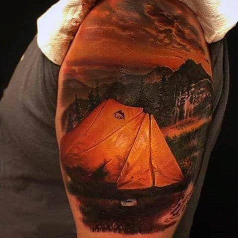 Guy With Realistic Tattoo Of Camping At Night On Bicep