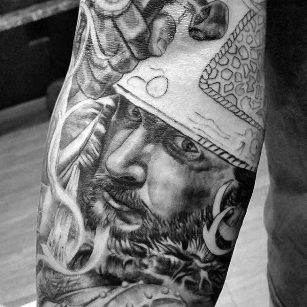 Guy With Realistic Warrior Face Tattoo On Arms