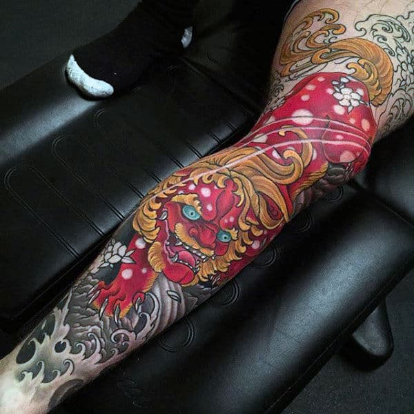 Guy With Red Ink Foo Dog Leg Sleeve Tattoo