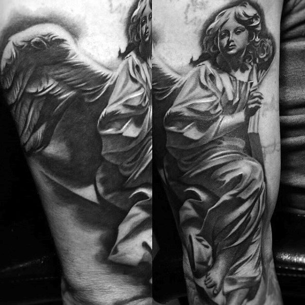 Guy With Religious Angelic Tattoo On Arms