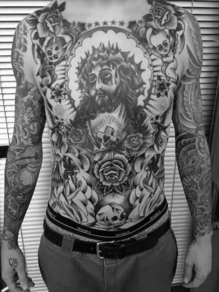 Guy With Religious Traditional Themed Tattoo On Chest