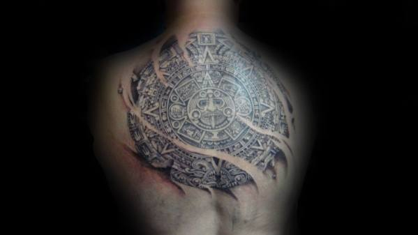 Guy With Ripped Skin Back Mayan Calender Tattoo Design