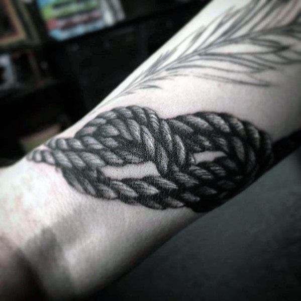 Guy With Rock Climbing Rope Wrist Tattoo Design