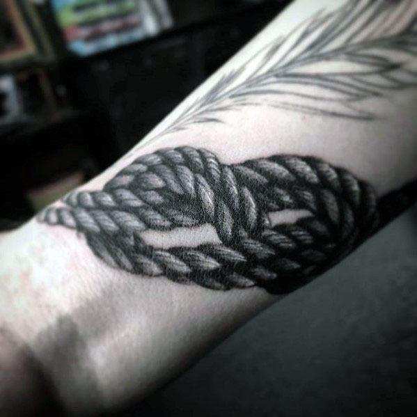 Guy With Rock Climbing Rope Wrist Tattoo Design