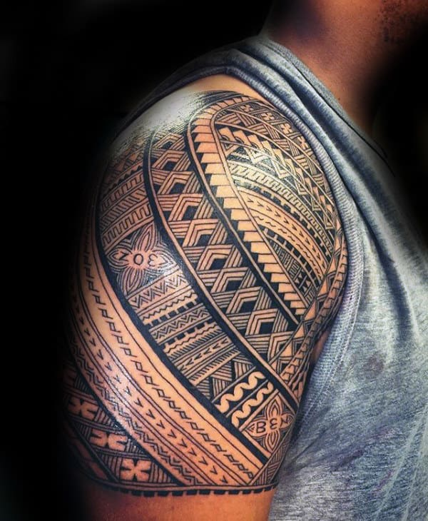 Guy With Samoan Tribal Half Sleeve Tattoo Design