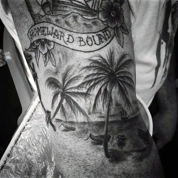 Guy With Scenic Palm Tree Tattoo On Arms