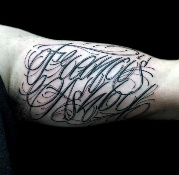 Guy With Script Bicep Lettering Decorative Tattoo