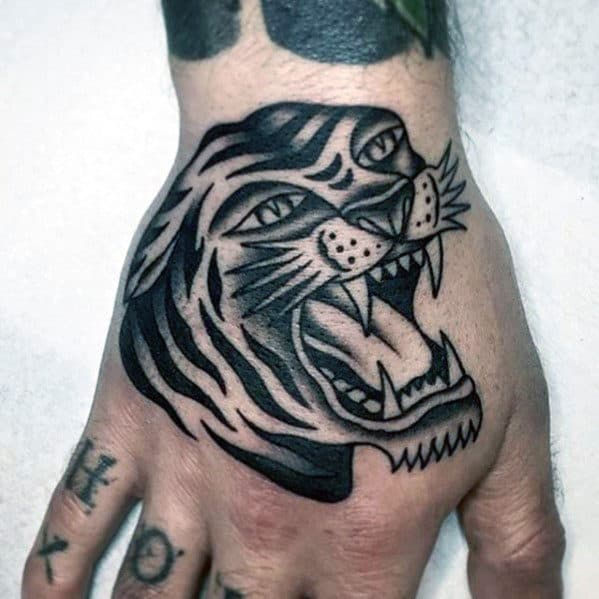 Guy With Shaded Black And Grey Traditional Roaring Tiger Hand Tattoo