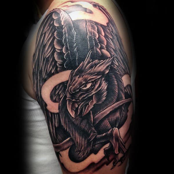 Guy With Shaded Dark Griffin Arm Tattoo