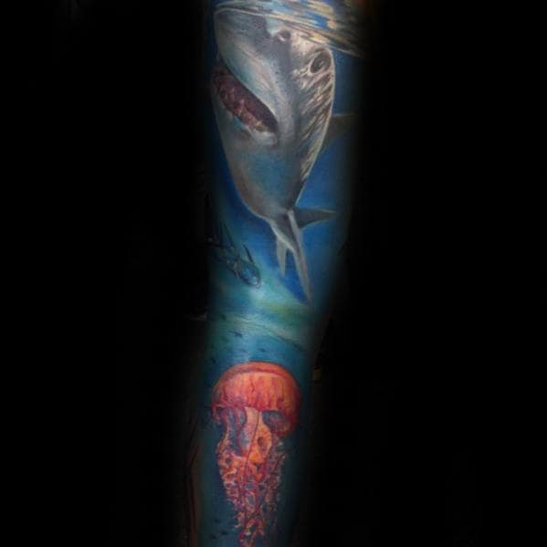 Guy With Shark And Jellyfish Ocean Sleeve Tattoo