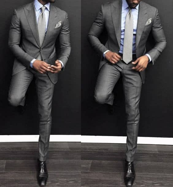 Guy With Sharp Looking Light Blue Dress Shirt Charcoal Grey Suit And Tie Black Shoes Outfit