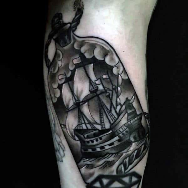 Guy With Ship In A Bottle Bicep Tattoo Shaded Black Ink Design