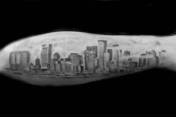 Guy With Skyline Outer Forearm Black And Grey Ink Shaded Tattoo Design