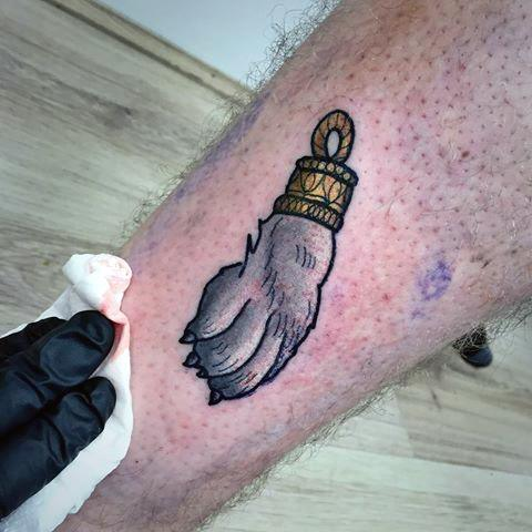 Guy With Small Rabbits Foot Tattoo Design On Leg