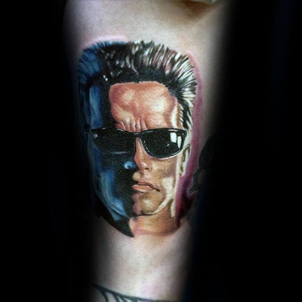 Guy With Small Terminator Arm Tattoo