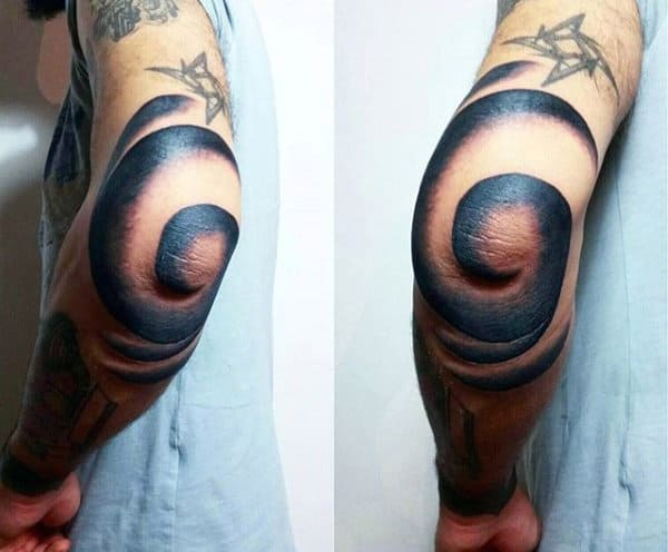 Guy With Spiral Elbow Tattoo In Blue Ink