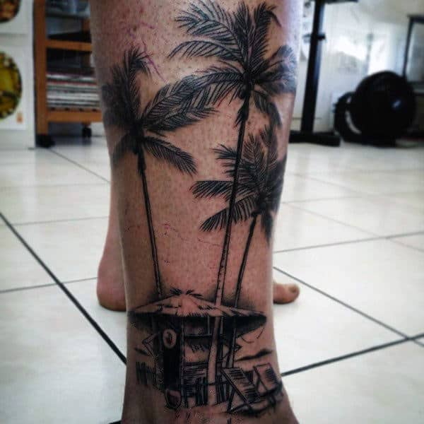 Guy With Straw Hut And Palm Trees Tattoo On Ankles