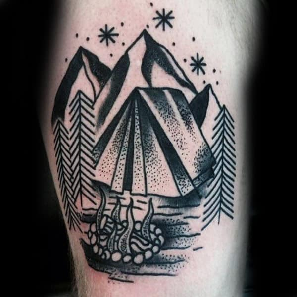 Guy With Stylized Black Outline Tattoo Camping Under Mountain Thigh