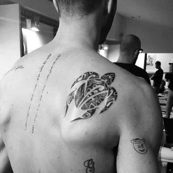 Guy With Swimming Turtle On Shoulder Blade Tribal Tattoos