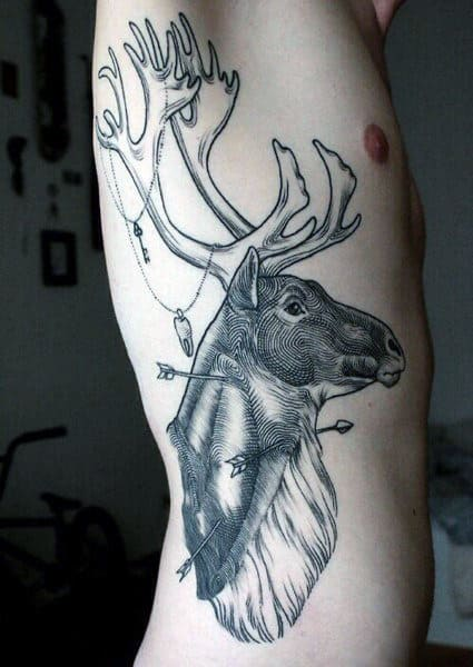 Guy With Tattoos Deer On Ribcage