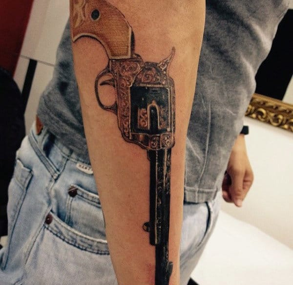 Guy With Terrific Pistol Tattoo On Forearms