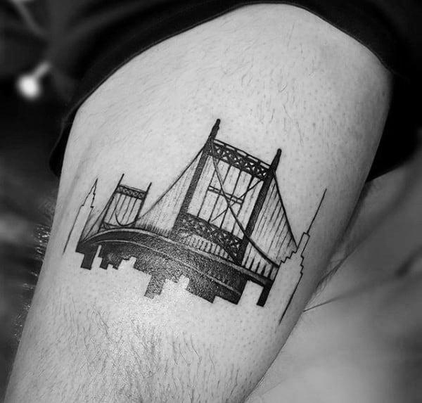 Guy With Thigh Bridge Tattoo