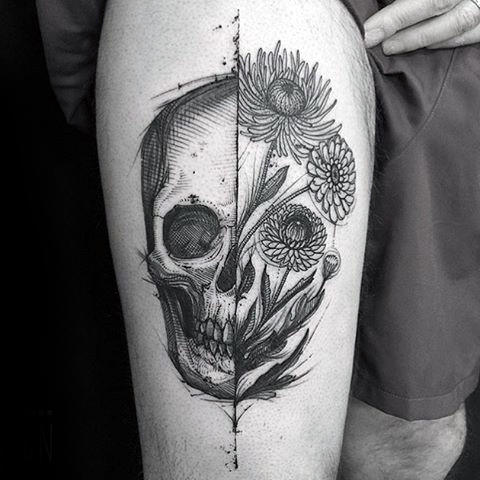 Guy With Thigh Tattoo Of Life Death Skull And Flowers
