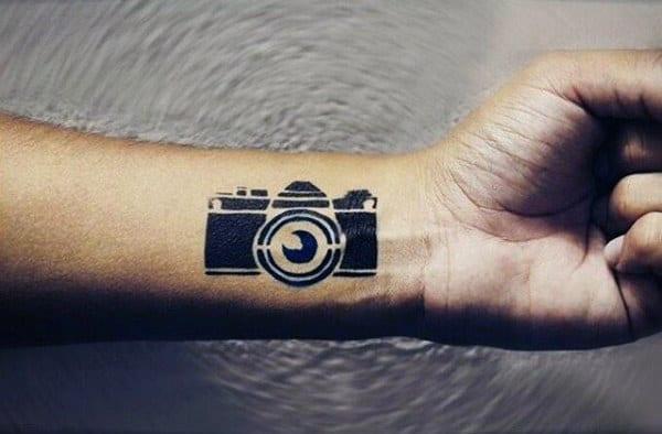Guy With Tiny Black Camera Tattoo Forearms