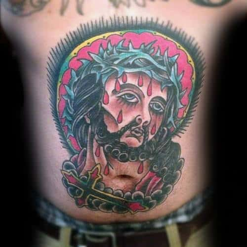 Guy With Traditional Cross Tattoo Design