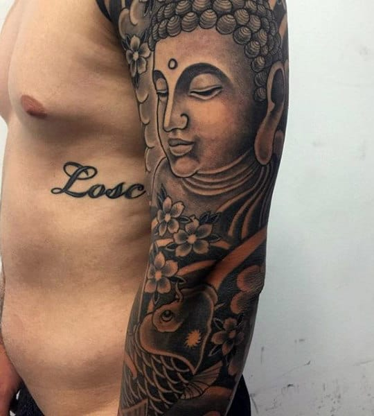 Guy With Traditional Dark Buddhist Tattoo On Arms