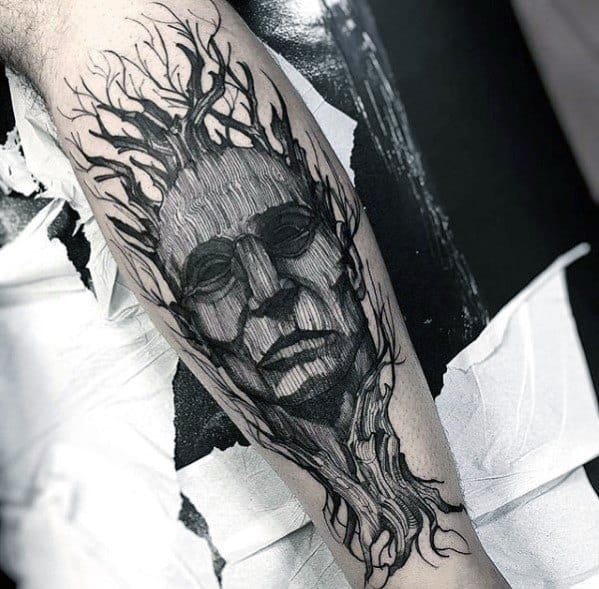 Guy With Tree Leg Tattoo