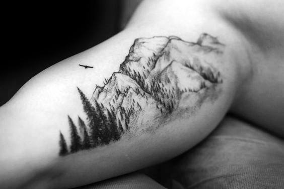Guy With Treeline Tattoo On Inner Arm Bicep