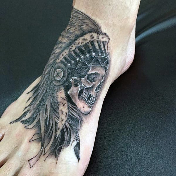 Guy With Tribal Skull Head Tattoo On Foot