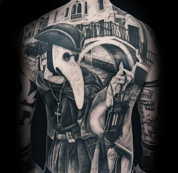Guy With Unique Cool Bridge And Religious Themed Full Back Tattoos