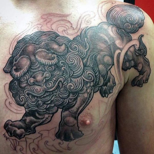 Guy With Upper Chest Foo Dog Tattoo