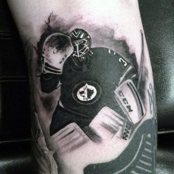 Guy With Watercolor Hockey Golaie Tattoo On Arm