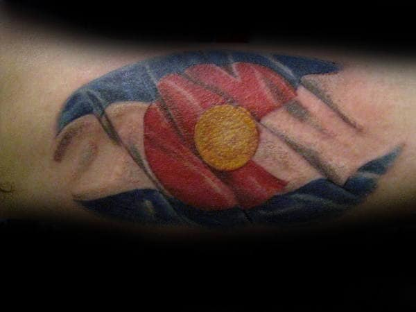 Guy With Waving Colorado Flag Tattoo On Arms