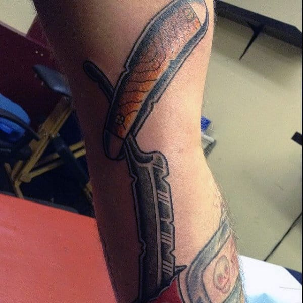 Guy With Wonderful Straight Razor Tattoo On Forearm