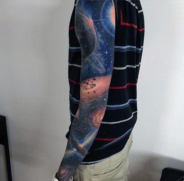 Guy Wtih Marvellous Dark Universe Tattoo On Sleeve